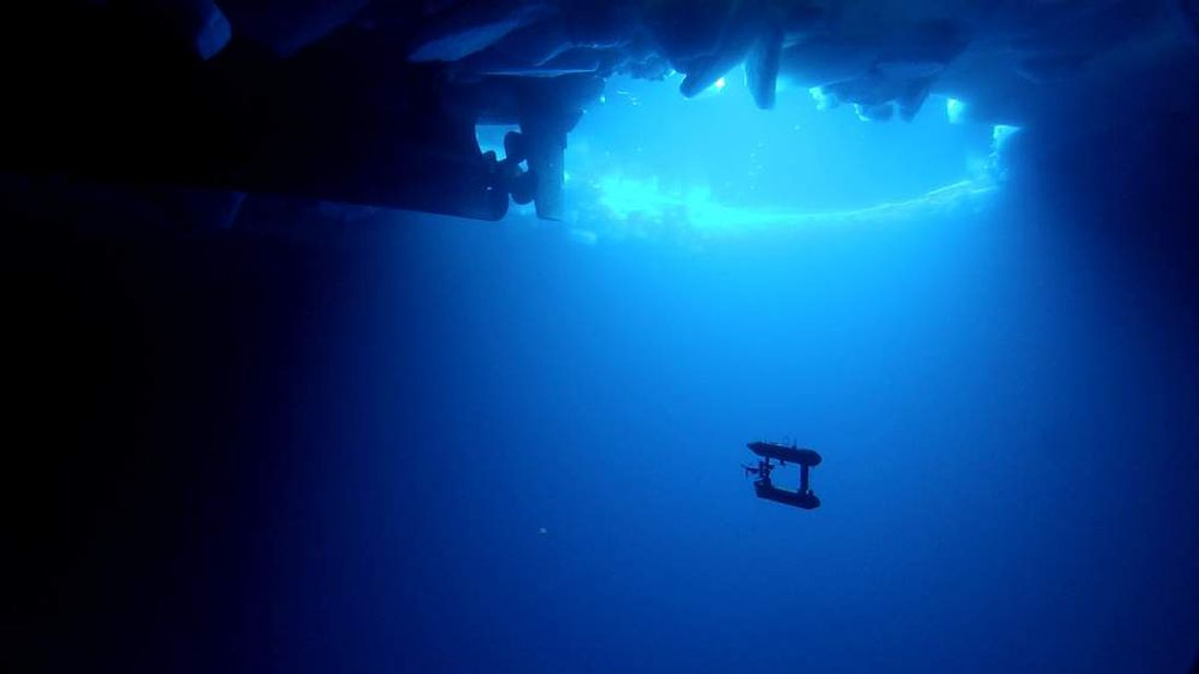 A view of the propeller of the Aurora Australis and the AUV under the ice. Photograph © AUV team/Australian Antarctic Division