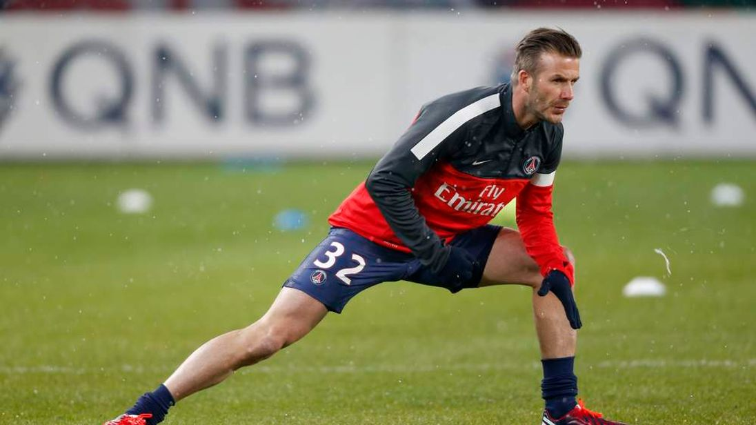 Paris Saint-Germain's Beckham warms up before the start of their French Ligue 1 soccer match against Olympic Marseille at Parc des Princes stadium in Paris