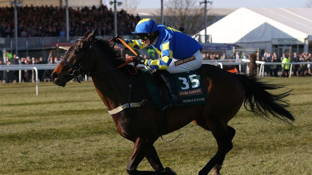 Ryan Mania riding Auroras Encore races to win the John Smiths Grand National Steeple Chase at Aintree Racecourse
