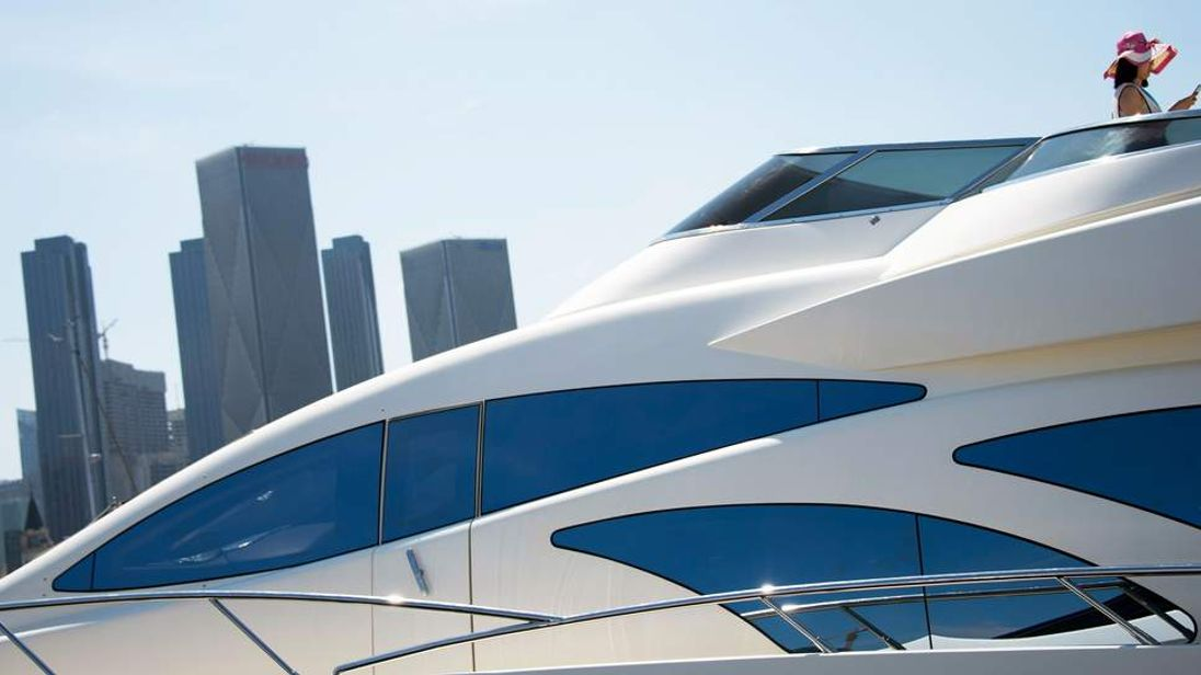 Chinese woman on a luxury yacht