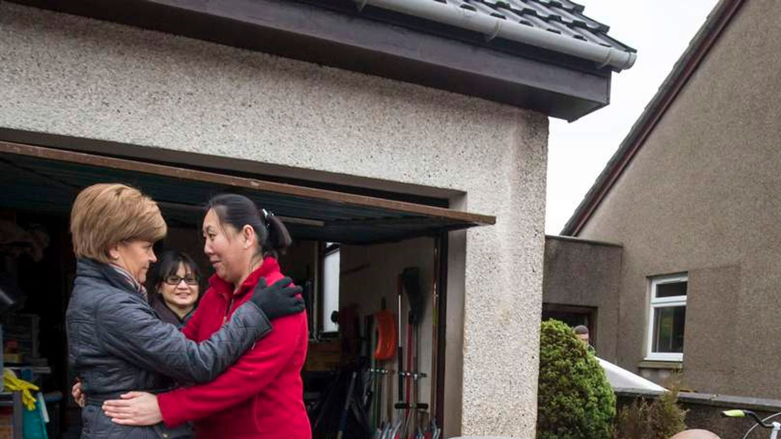Nicola Sturgeon hugs a local resident during a visit to flood-hit Port Elphinstone