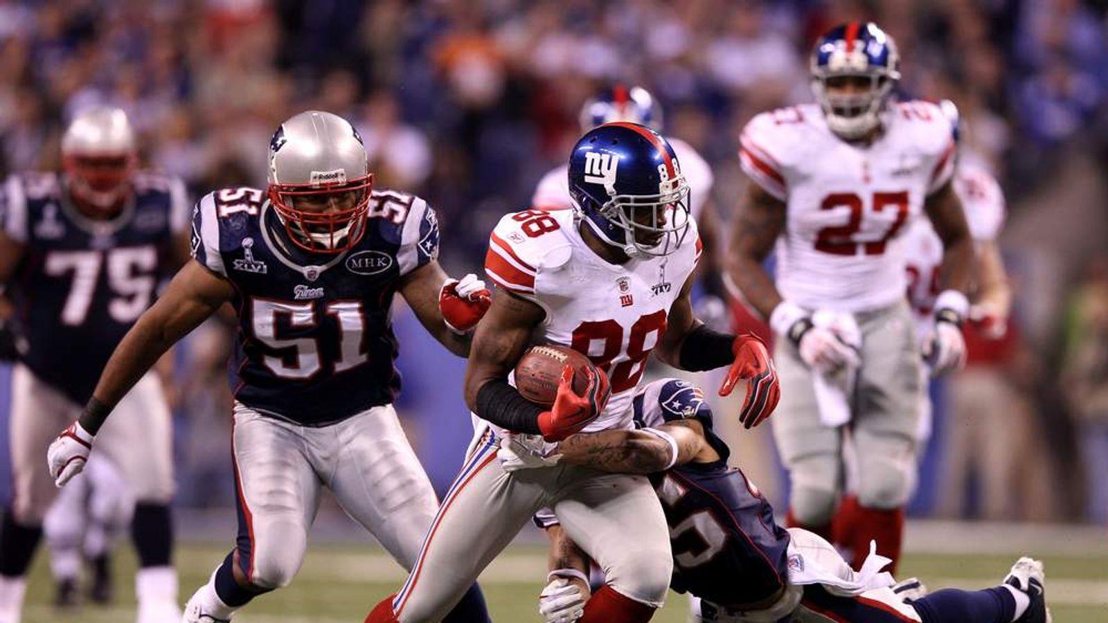 Hakeem Nicks of the New York Giants runs against the New England Patriots during Super Bowl XLVI