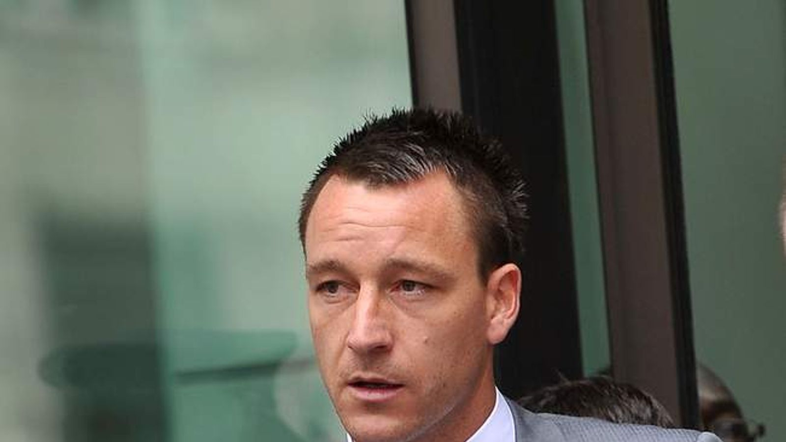 John Terry leaves court after a not guilty verdict was reached of his alleged racial abuse trial on July 13, 2012 in London