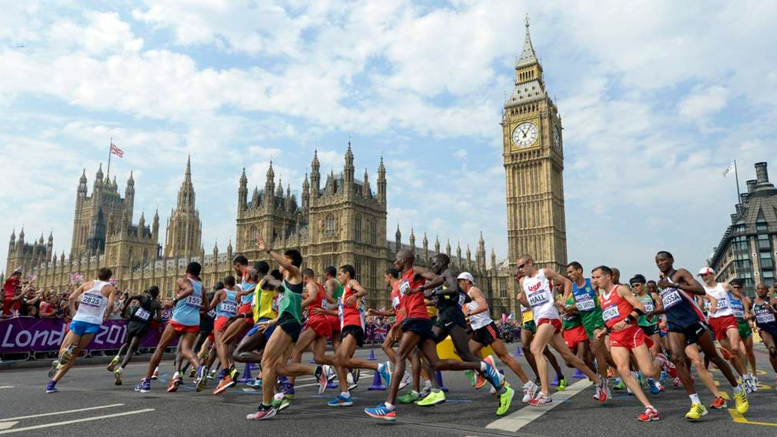 Athletes run in front of Big Ben during the men's marathon in London.