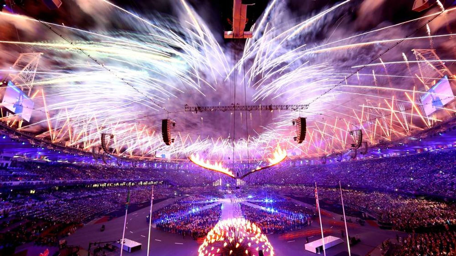 Fireworks expload as the Olympic Cauldron is slowly lowered during the Closing Ceremony on Day 16 of the London 2012 Olympic Games