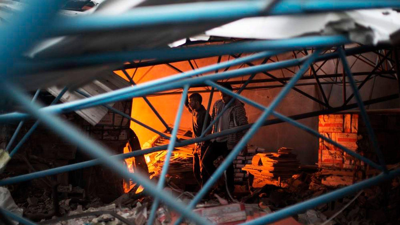 Debris of burning factory in Gaza City