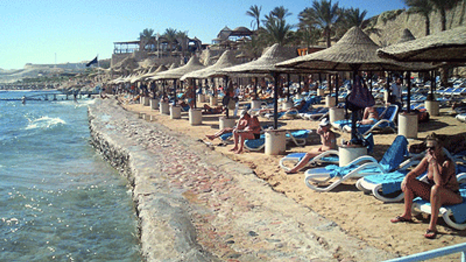 Tourists at a beach with a swimming ban at the Red Sea resort of Sharm el-Sheikh, December 2, 2010.