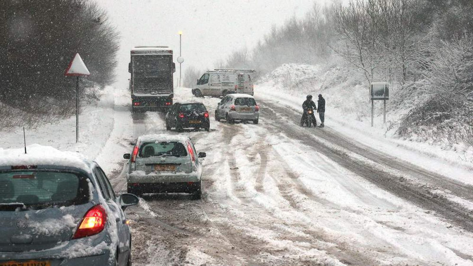 Vehicles struggle in the snow