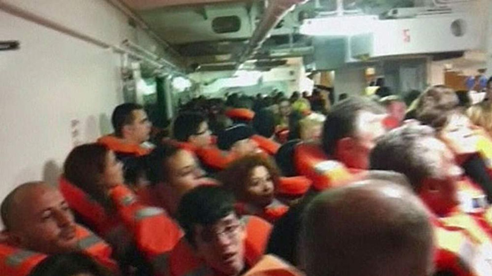 Amateur video showed passengers wearing life jackets crowded on the outer decks waiting to get on to lifeboats after the Costa Concordia ran aground off Italy's coast.