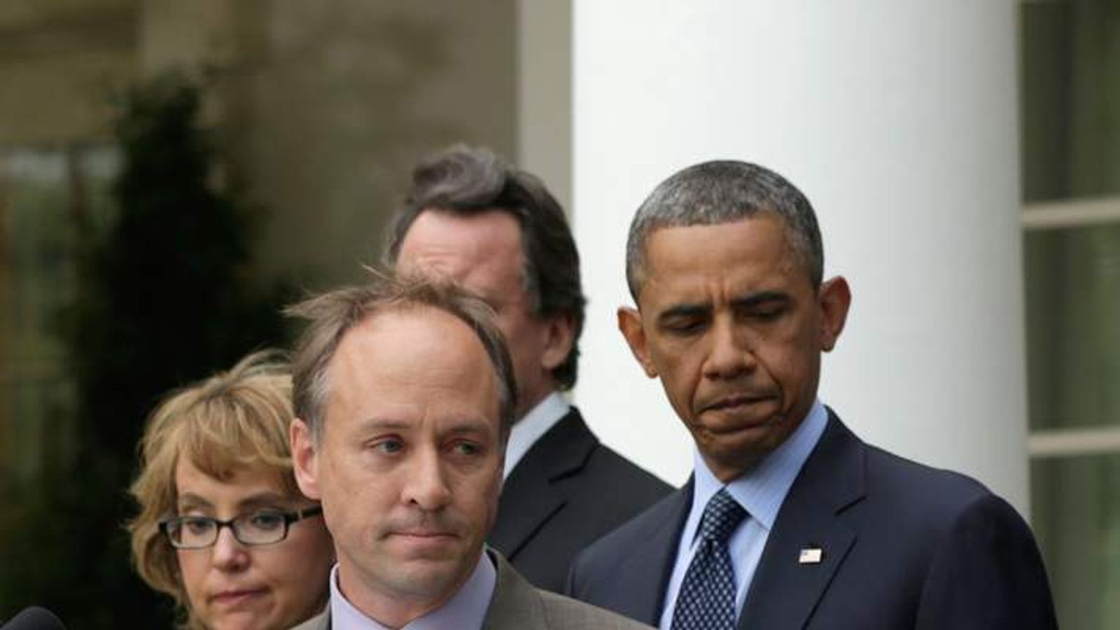The president comforts Sandy Hook parent Mark Barden