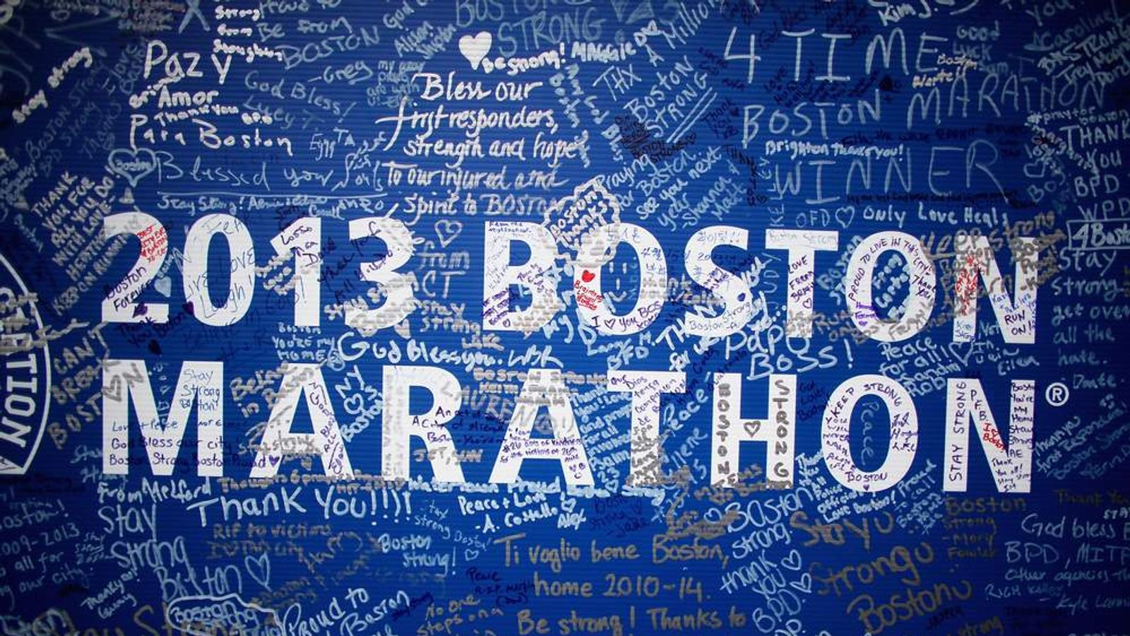 Signatures adorn a Boston Marathon poster near the site of the Boston Marathon bombings