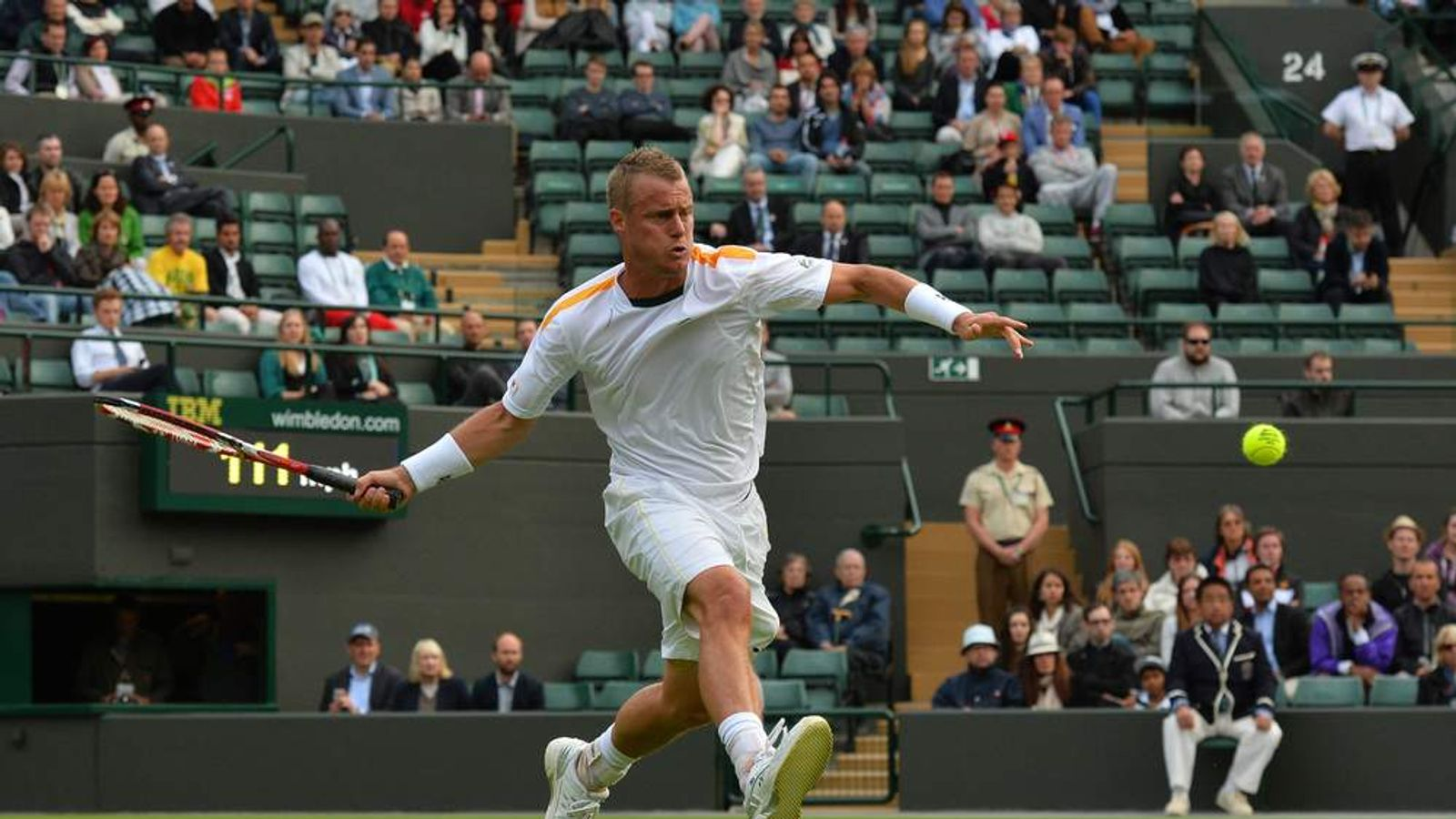 Australia's Lleyton Hewitt returns against Switzerland's Stanislas Wawrinka during their men's first round match on day one of the 2013 Wimbledon Championships
