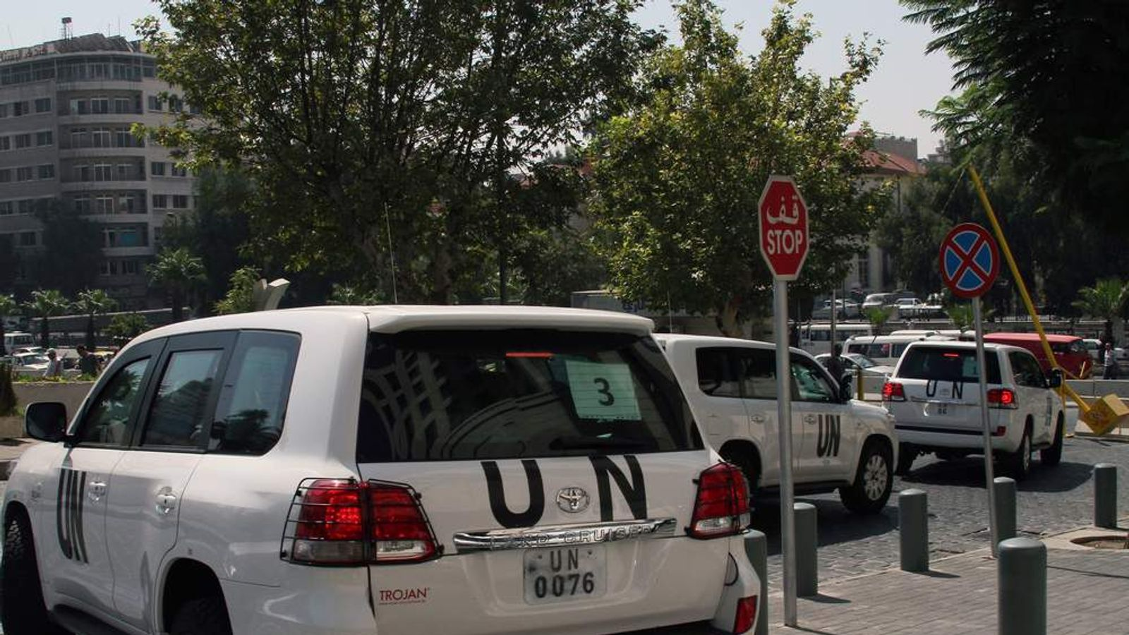 A convoy of United Nations (UN) vehicles leave a hotel in Damascus, Syria