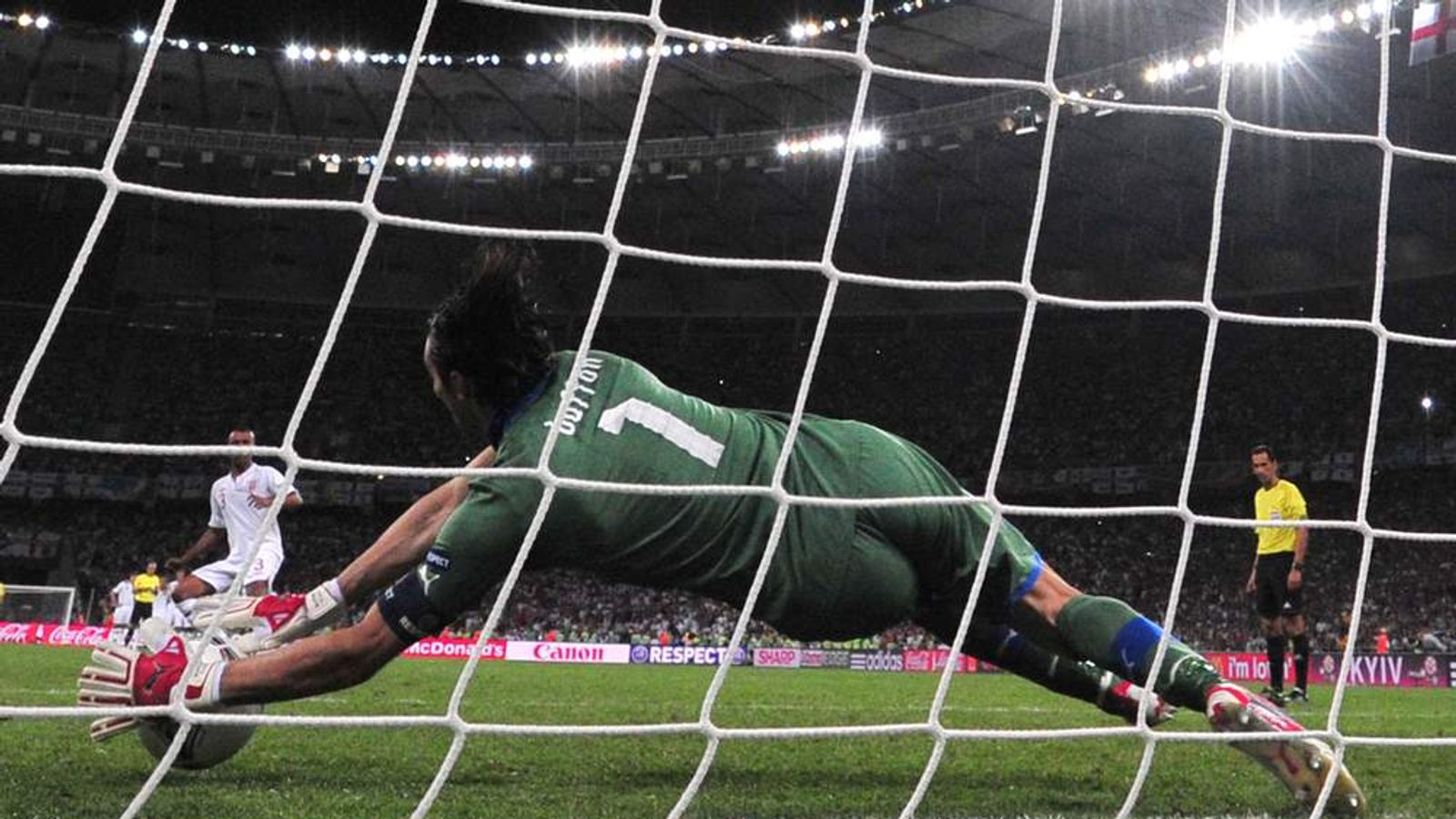 English defender Ashley Cole has his penalty saved by Italian goalkeeper Gianluigi Buffon