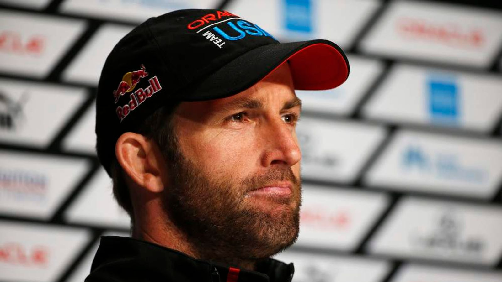 Oracle Team USA tactician Ainslie speaks to members of the media after winning Race 18 of the 34th America's Cup yacht sailing race against Emirates Team New Zealand in San Francisco