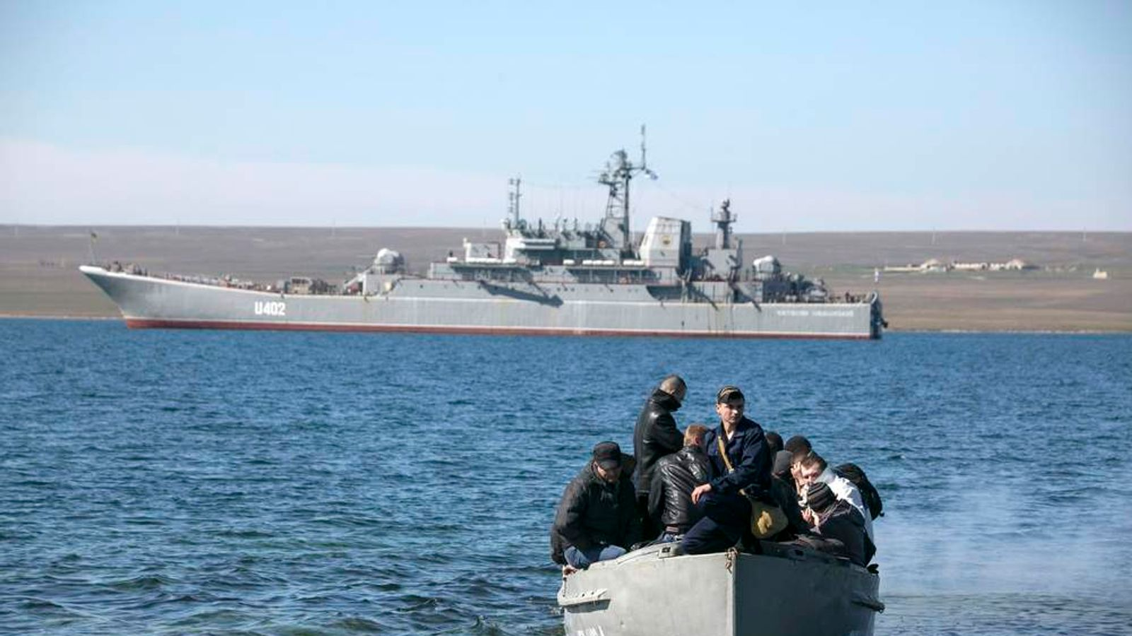 "Crew members of the blockaded Ukrainian naval landing vessel ""Konstantin Olshansky"" come ashore after leaving the ship in Donuzlav bay in Crimea"