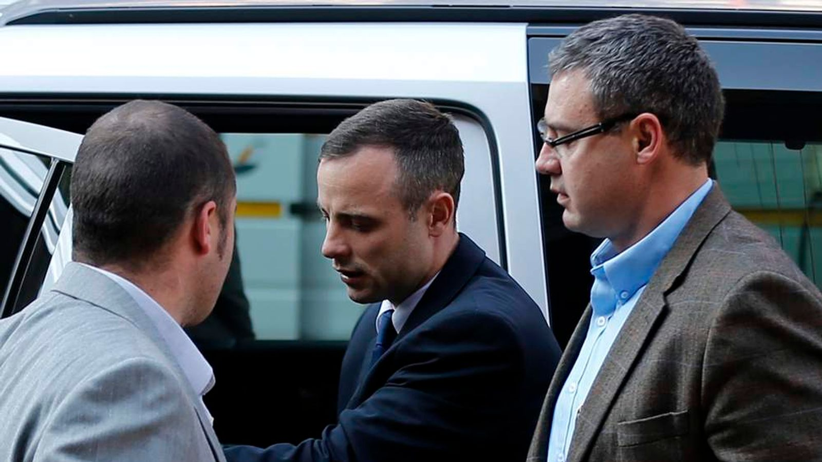 Oscar Pistorius  arrives ahead of his trial at North Gauteng High Court in Pretoria