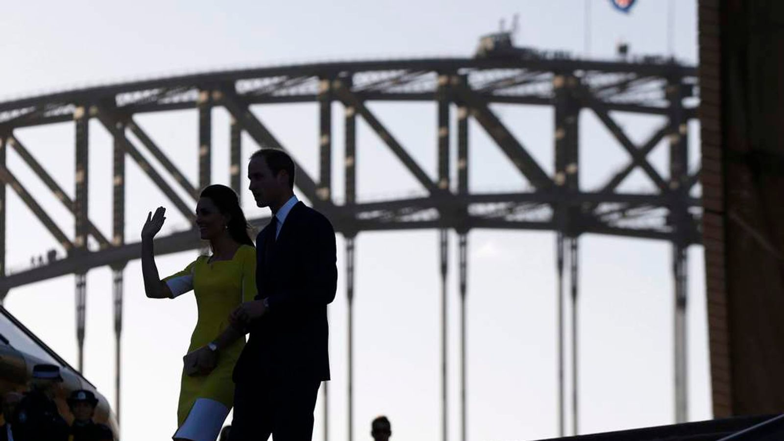 Britain's Prince William and Catherine, Duchess of Cambridge, are silhouetted against the Sydney Harbour Bridge