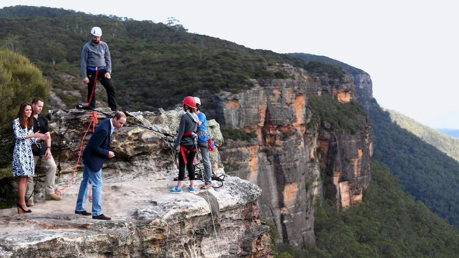 Britain's Prince William observes abseiling by the Mountain Youth Services group near his wife Catherine, the Duchess of Cambridge, as they visit Narrow Neck Lookout in the Blue Mountains town of Katoomba