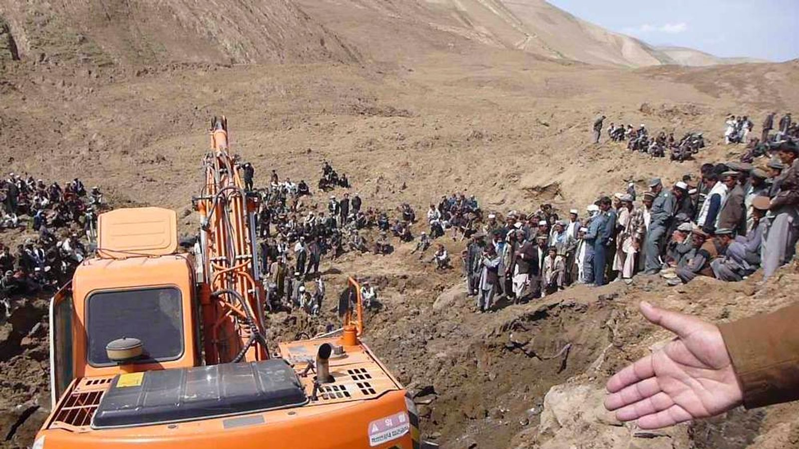 An excavator digs at the site of a landslide at the Argo district in Badakhshan province.