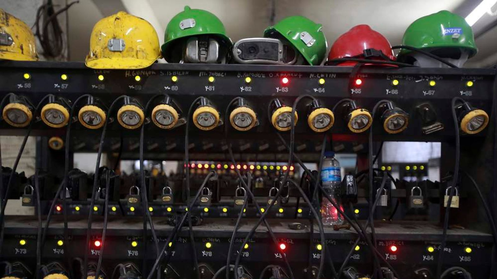 Headlights are charged inside a changing room of a coal mine after a mining disaster in Soma
