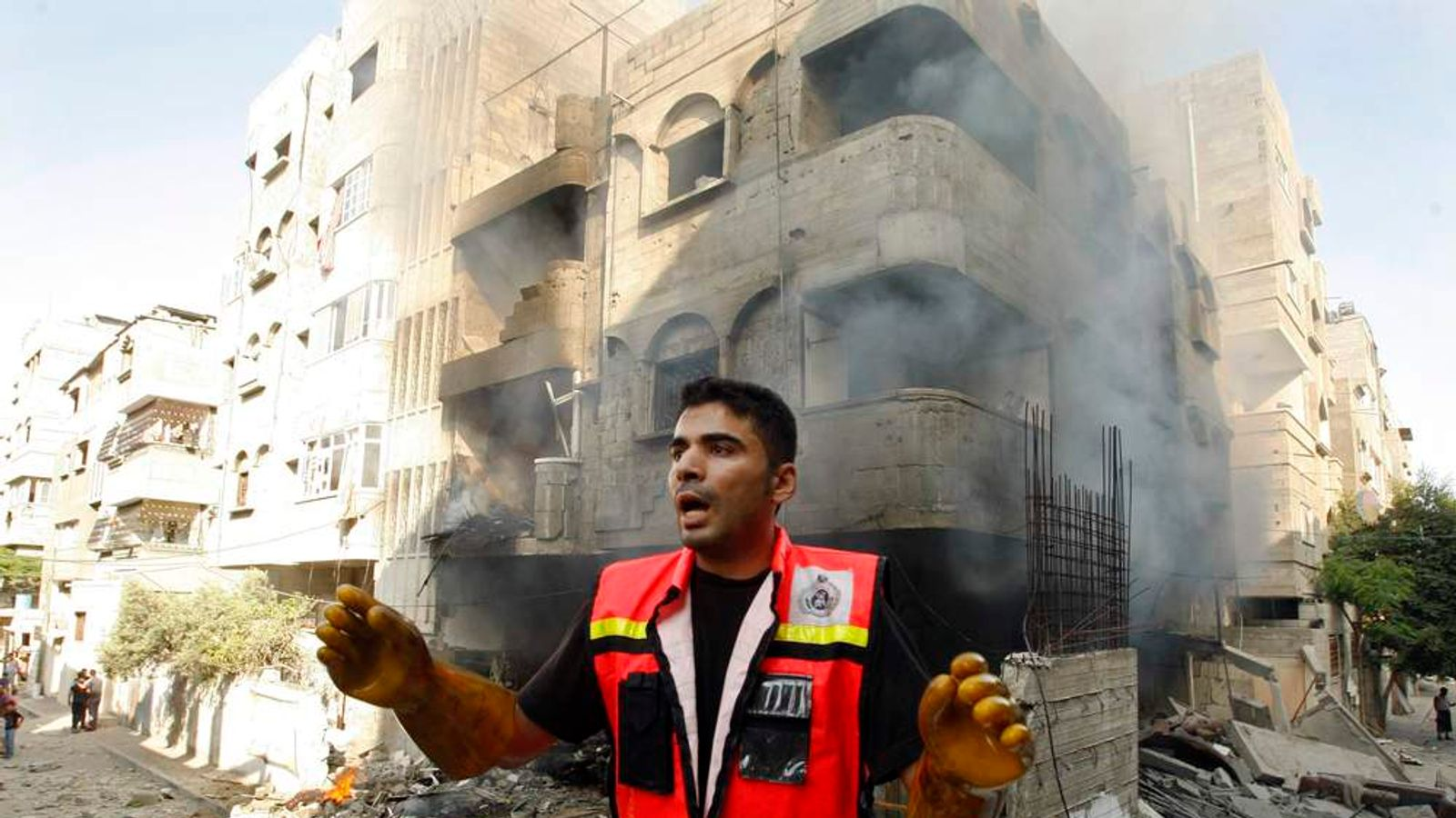 Member of the civil defence reacts after what police said was an Israeli air strike on a house, in Gaza City