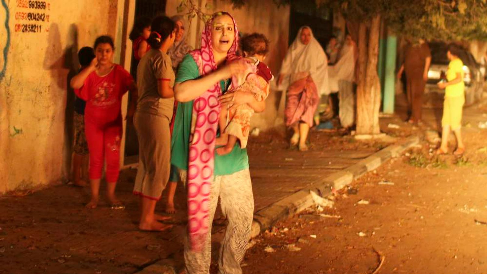 Palestinians flee their houses at the scene of what witnesses said was an Israeli air strike, in Gaza City