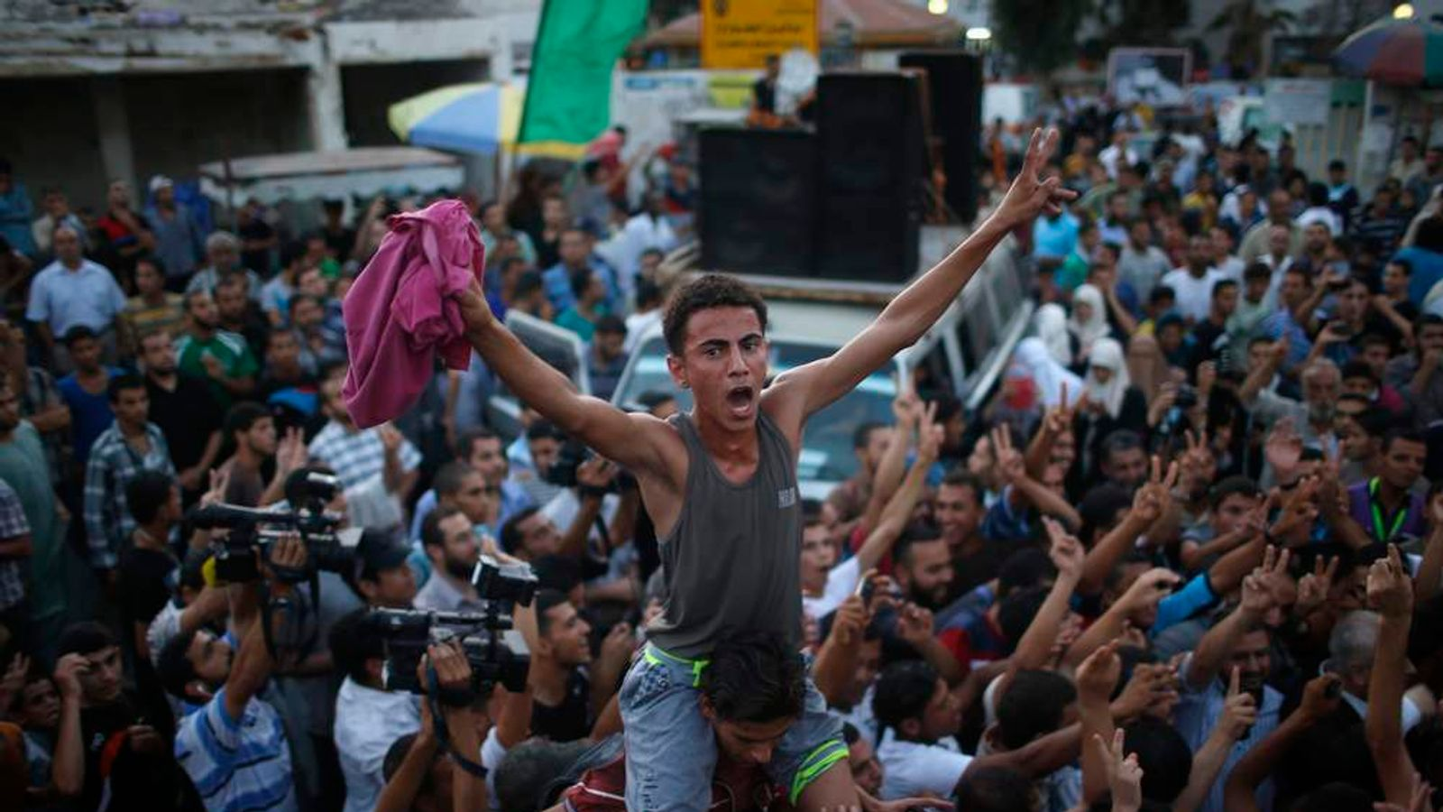 Palestinians celebrate what they said was a victory over Israel following a ceasefire in Gaza City
