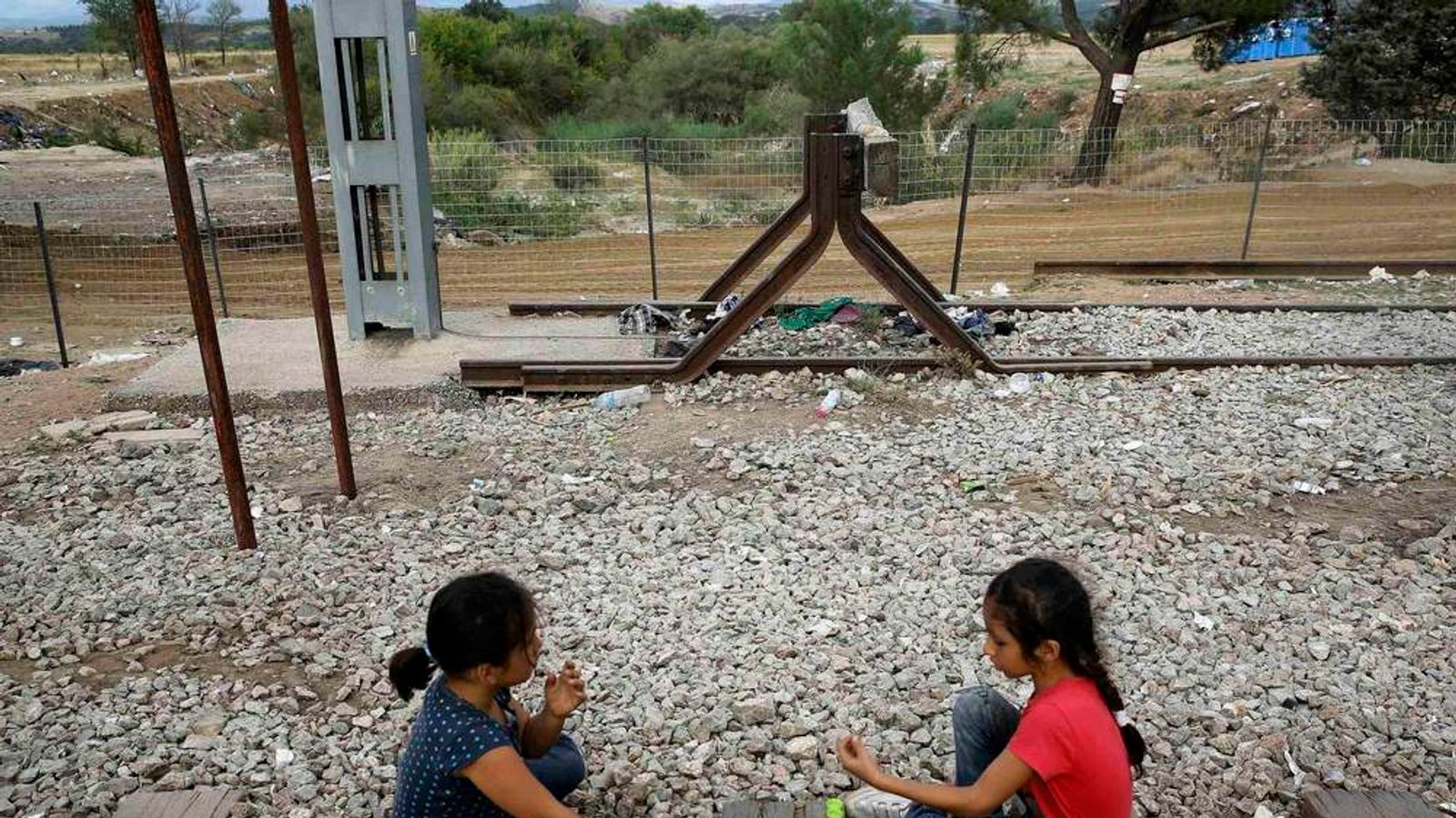 Syrian refugees play by rail tracks near Greece's border with Macedonia