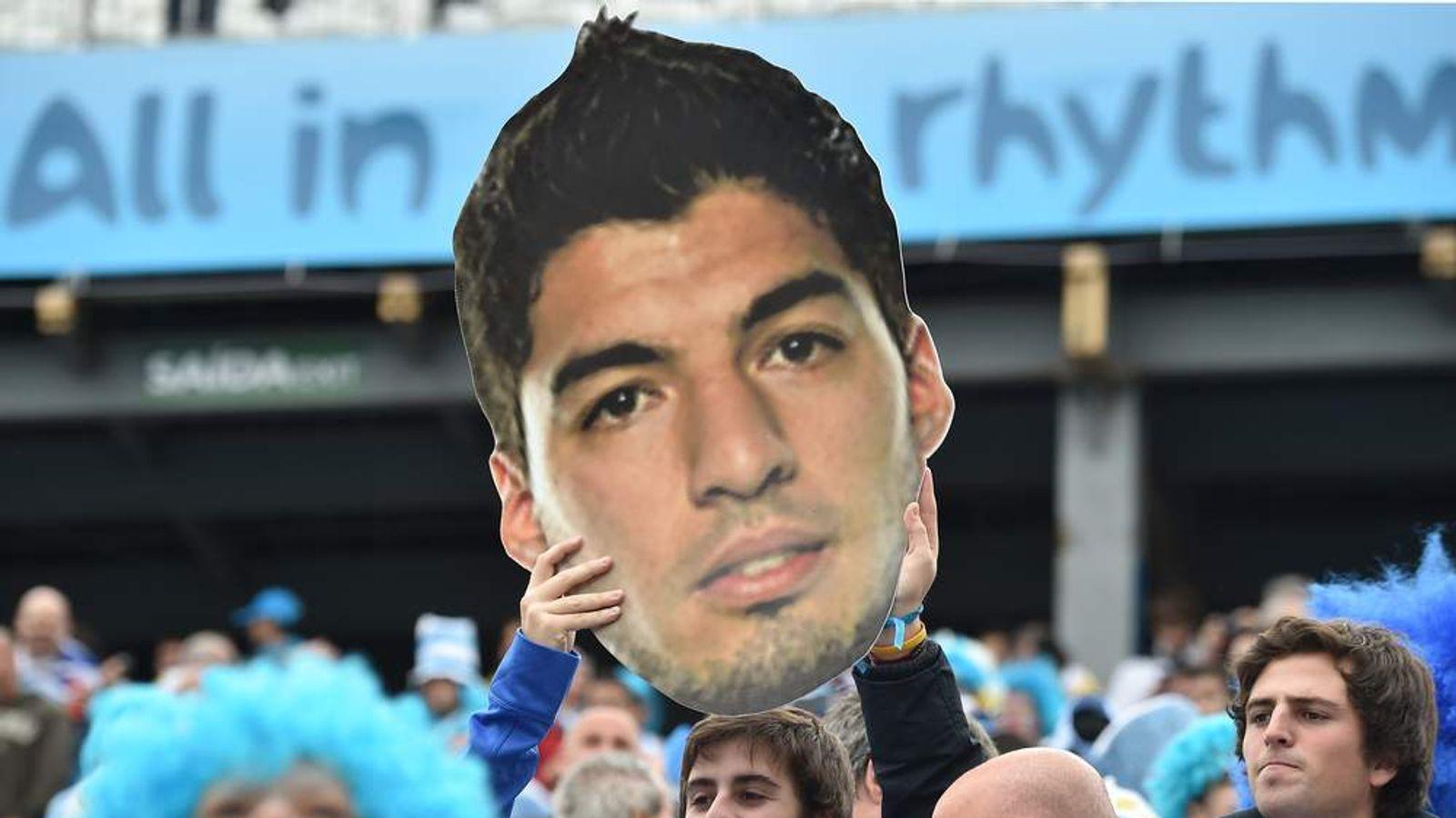 Uruguayan fans hold a giant board depecting Uruguay's forward Luis Suarez