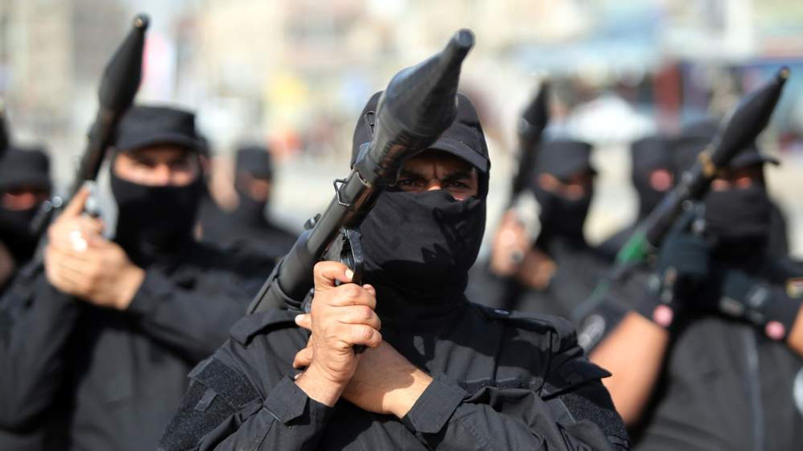 Iraqi Shia fighters parade with their weapons on June 21, 2014 in the capital, Baghdad.