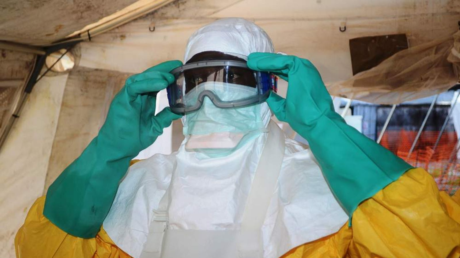 A member of Doctors Without Borders (MSF) putting on protective gear at the isolation ward of the Donka Hospital in Conakry.