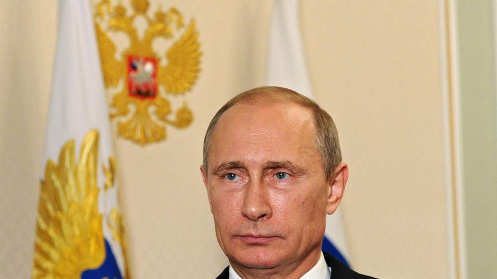 Russia's President Vladimir Putin looks on while recording his video address on the Malaysia Airlines crash.