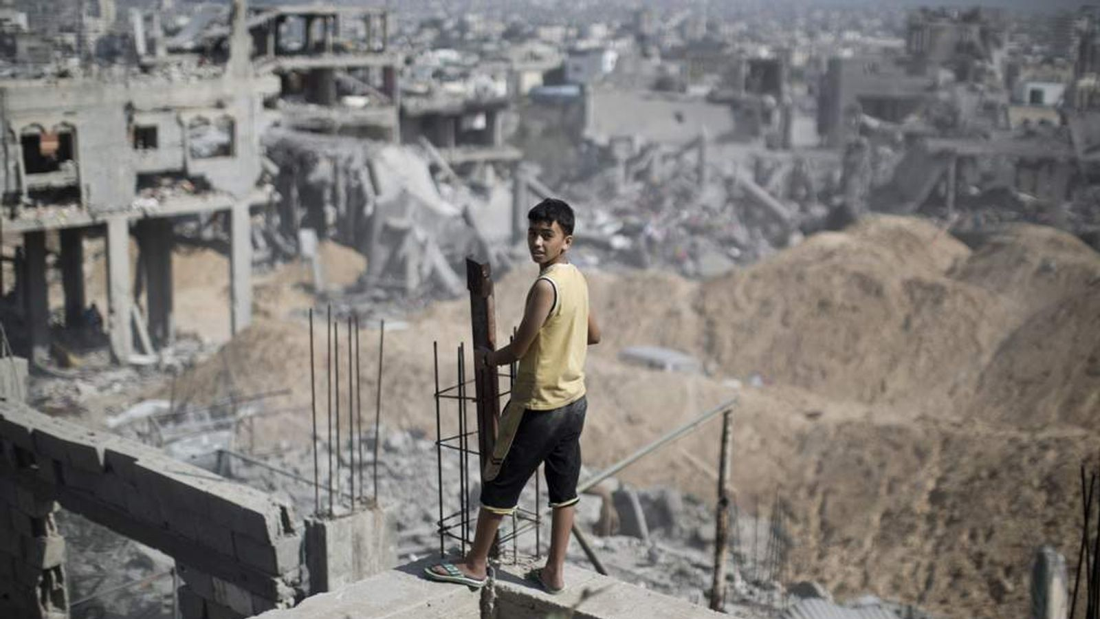 A Palestinian youth looks out at the destruction in part of Gaza City's al-Tufah neighbourhood