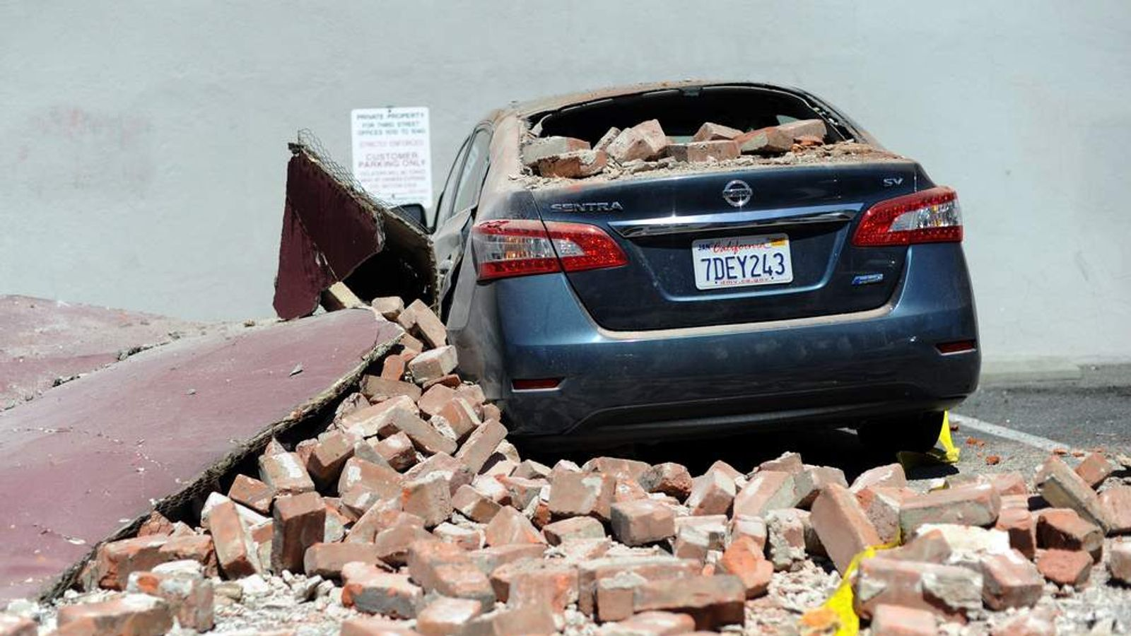 A car is damaged in the quake