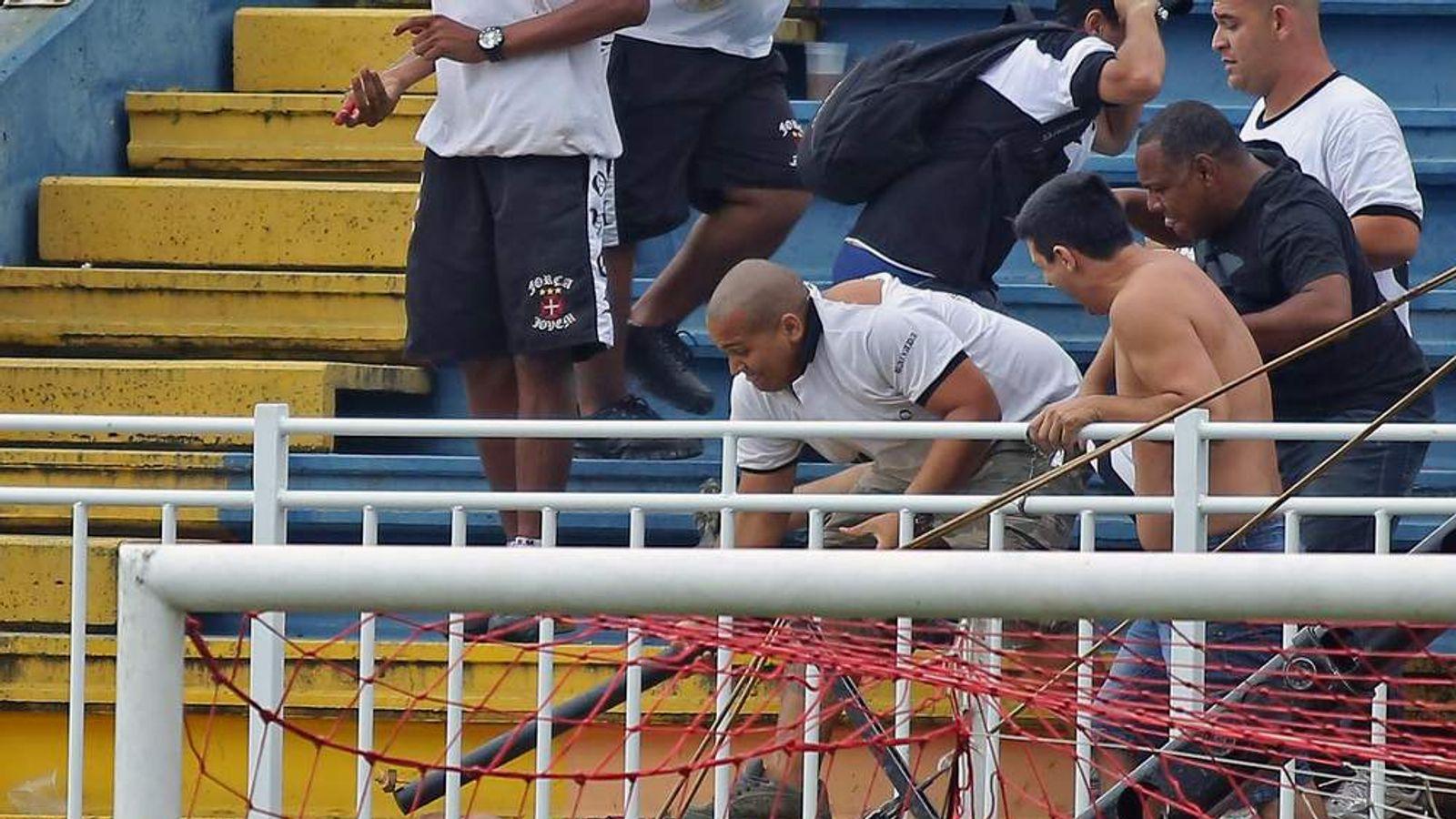 Fans of Rio de Janeiro's Vasco da Gama attack a fan of Parana's Atletico PR