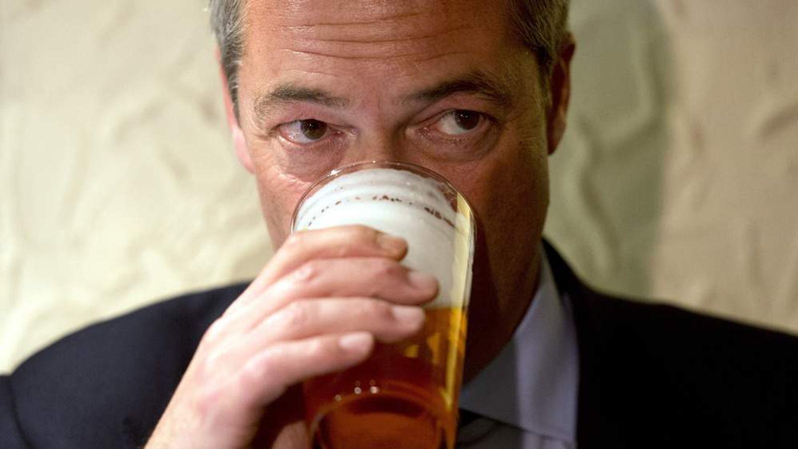 UKIP leader Nigel Farage drinks a pint of beer.