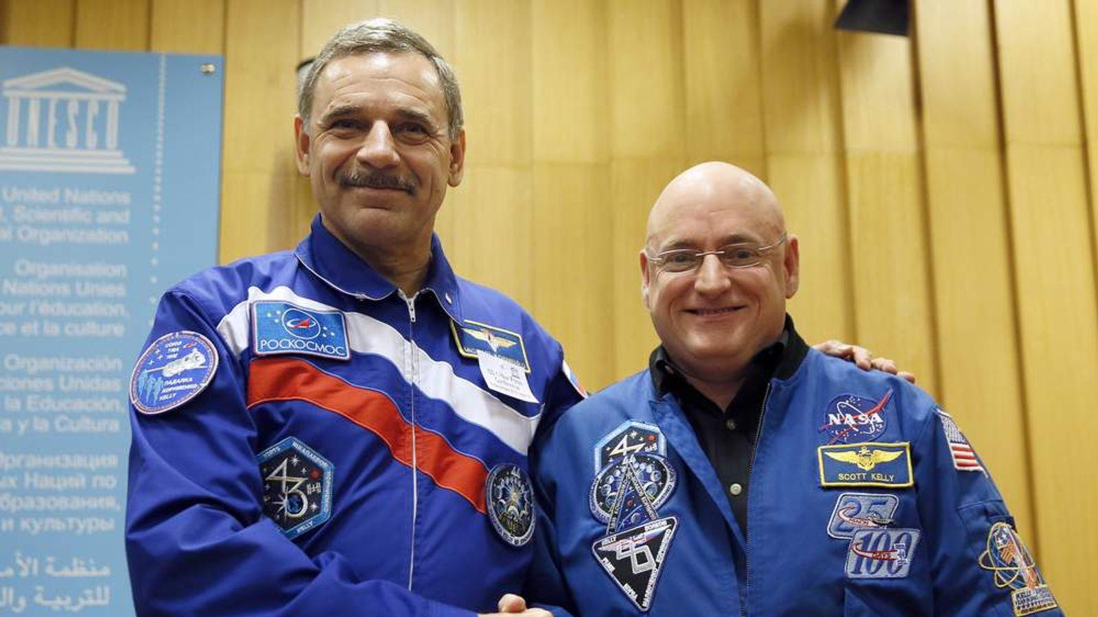 NASA astronaut Scott Kelly (R) and Roscosmos cosmonaut Mikhail Kornienko