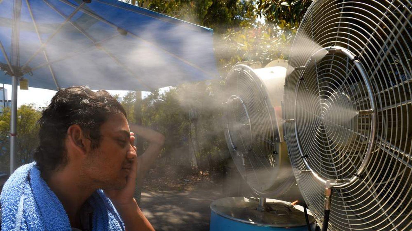 A tennis fan keeps cool in 40 degree heat at the Australian Open in Melbourne.