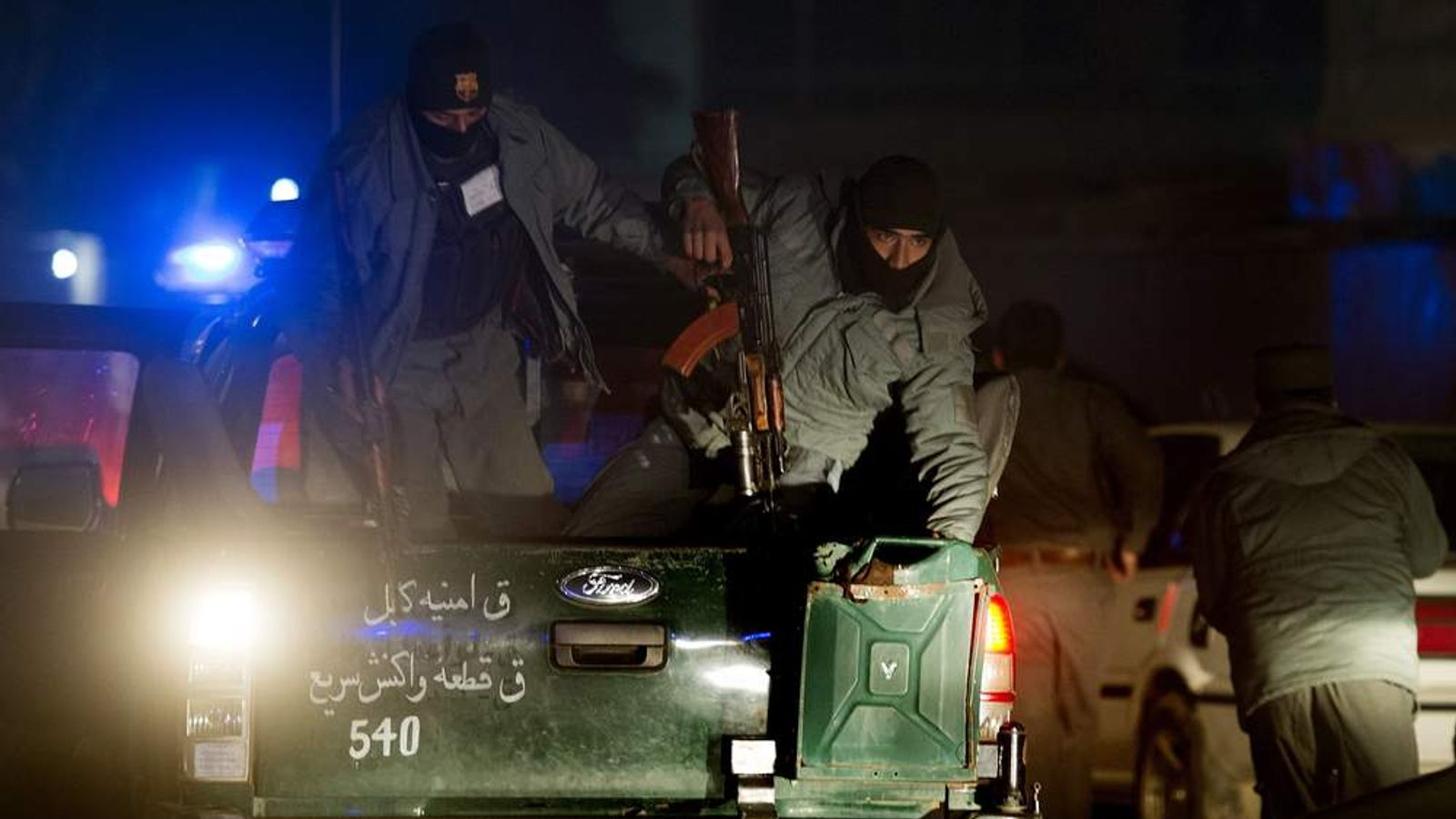 Afghan police and special force soldiers arrive at the scene of a suicide attack in Kabul
