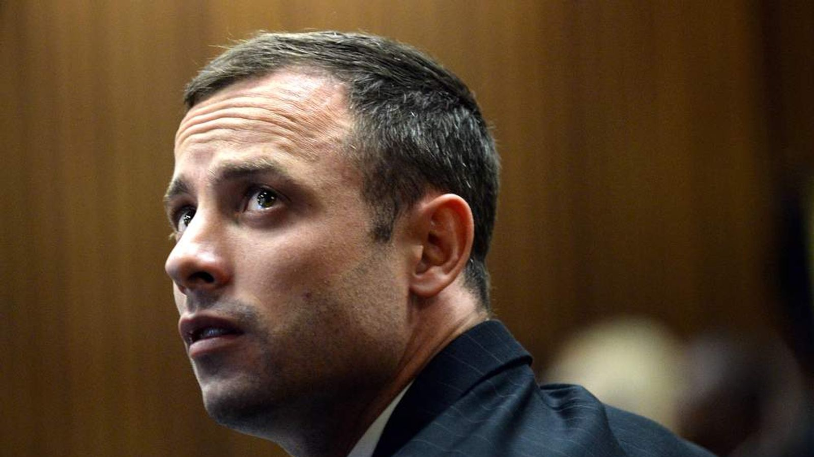 Oscar Pistorius prepares for the second day of his trial in Pretoria.
