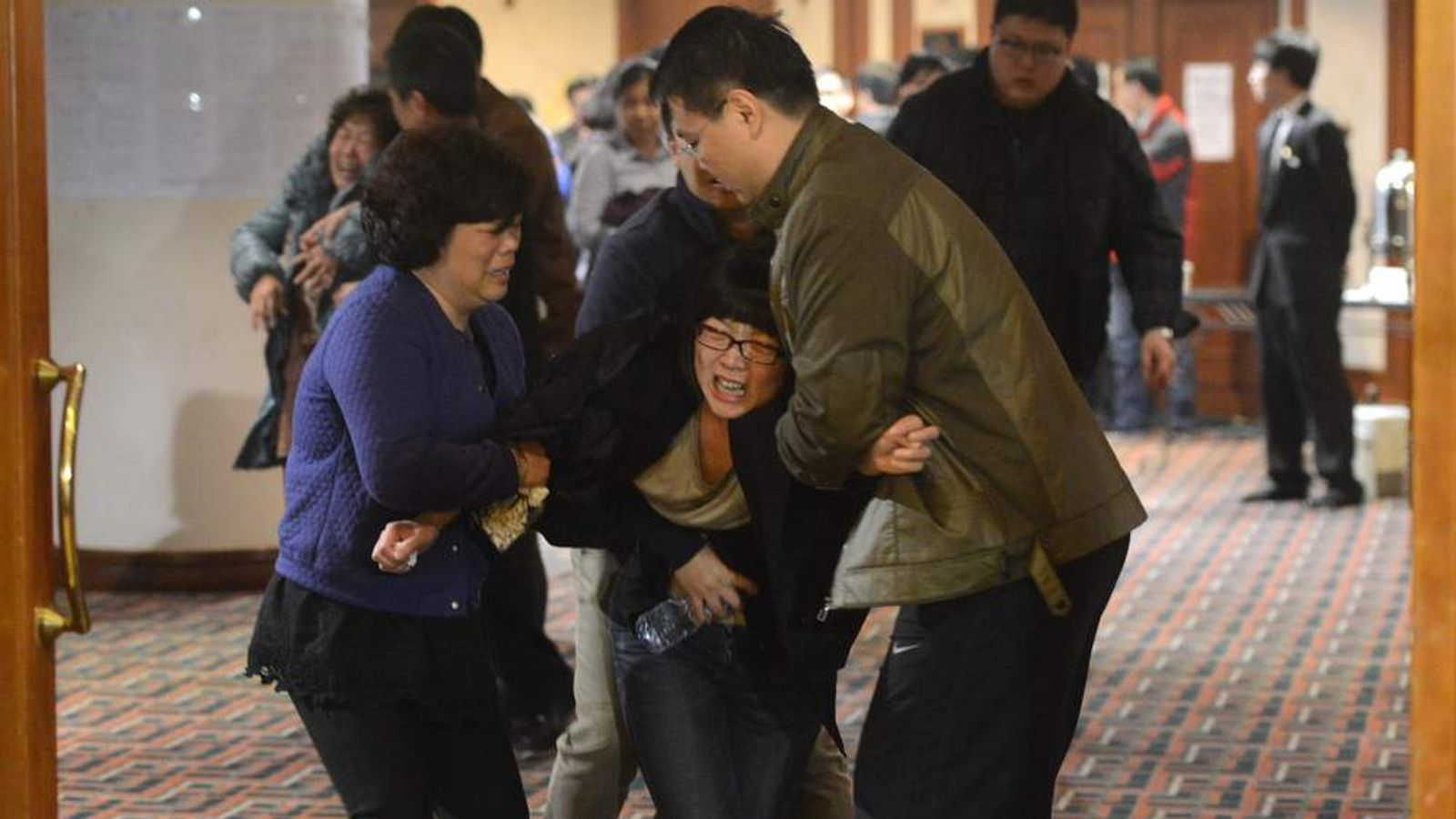 Relatives of passengers on Malaysia Airlines flight MH370 are told the plane was lost in the southern Indian Ocean.