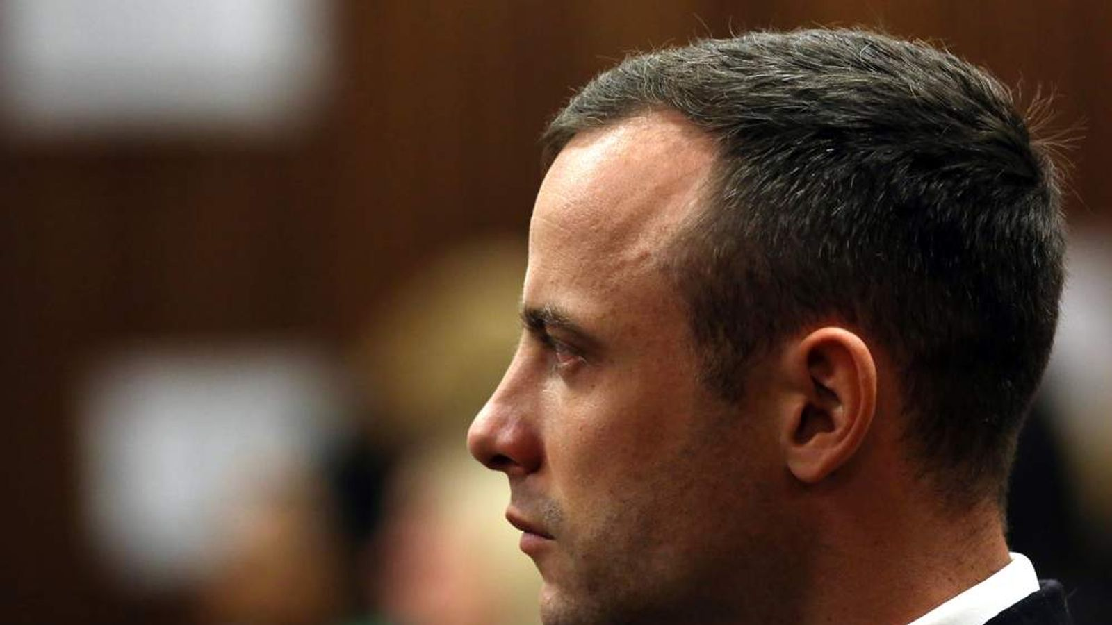 South African Paralympian Oscar Pistorius is seen in the dock at the North Guteng High Court in Pretoria.