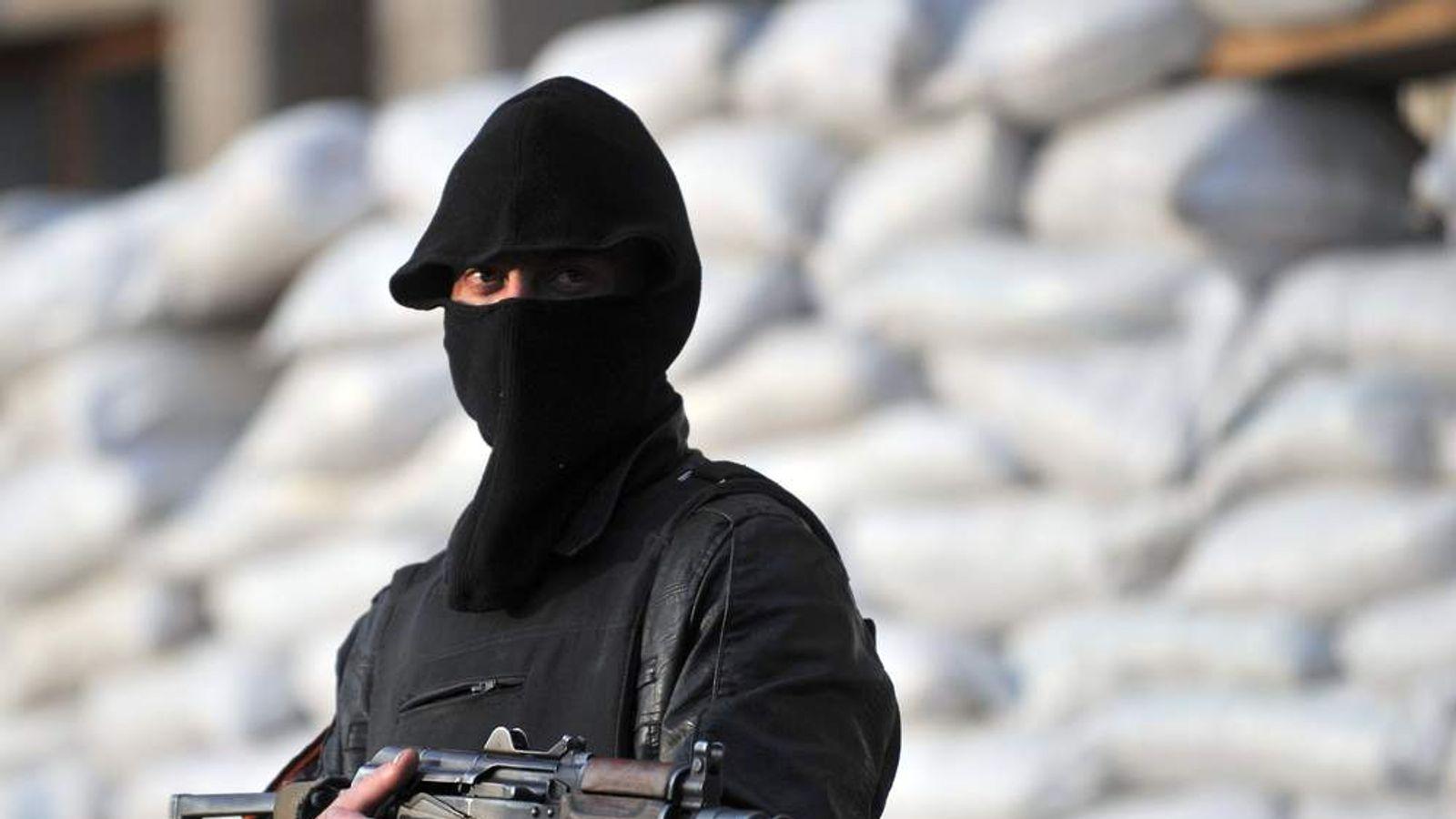 Masked man with gun
