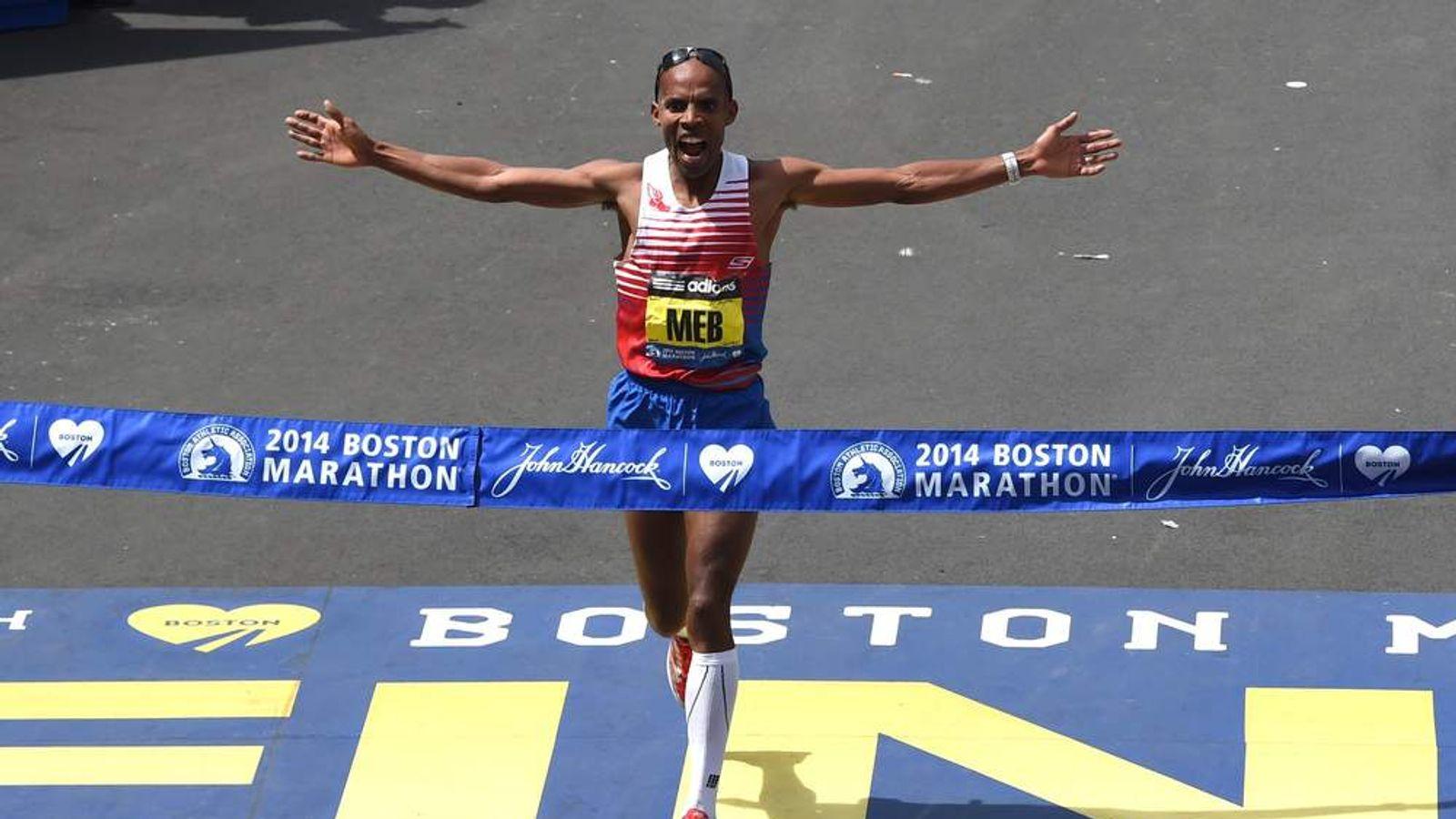 American Meb Keflizighi wins Boston Marathon a year after bombing.