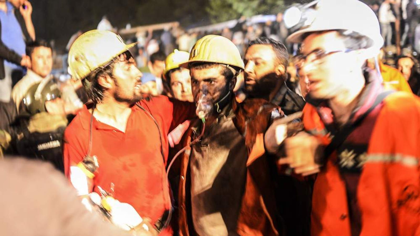 Workers wait outside a mine in Soma, Turkey, following an underground explosion