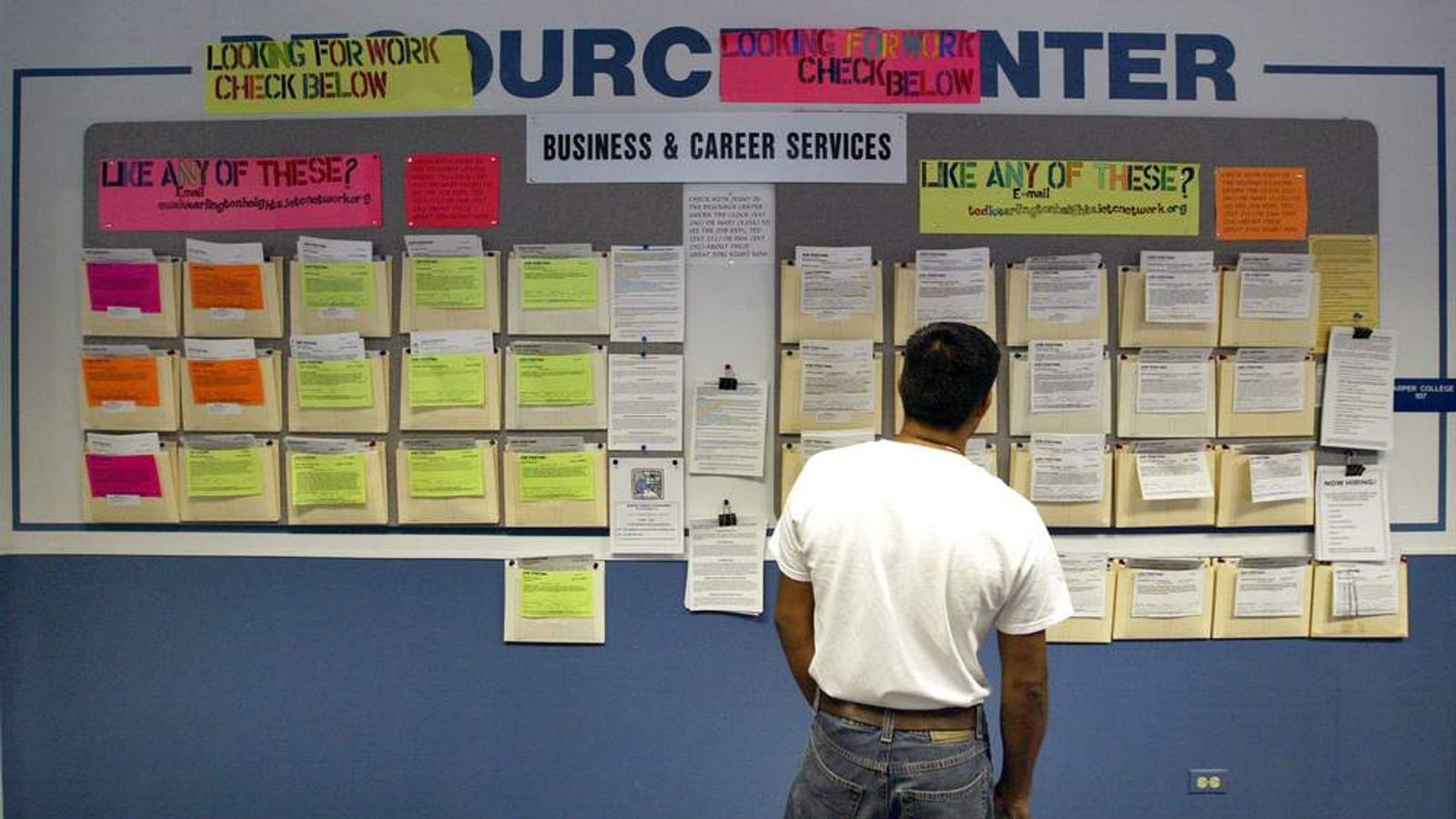 A job seeker searches for employment opportunities at an Illinois Employment and Training Centre