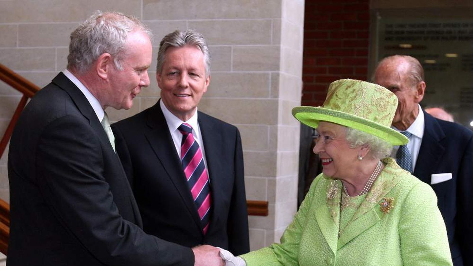 Queen Elizabeth II shakes hands with Northern Ireland Deputy First Minister Martin McGuinness