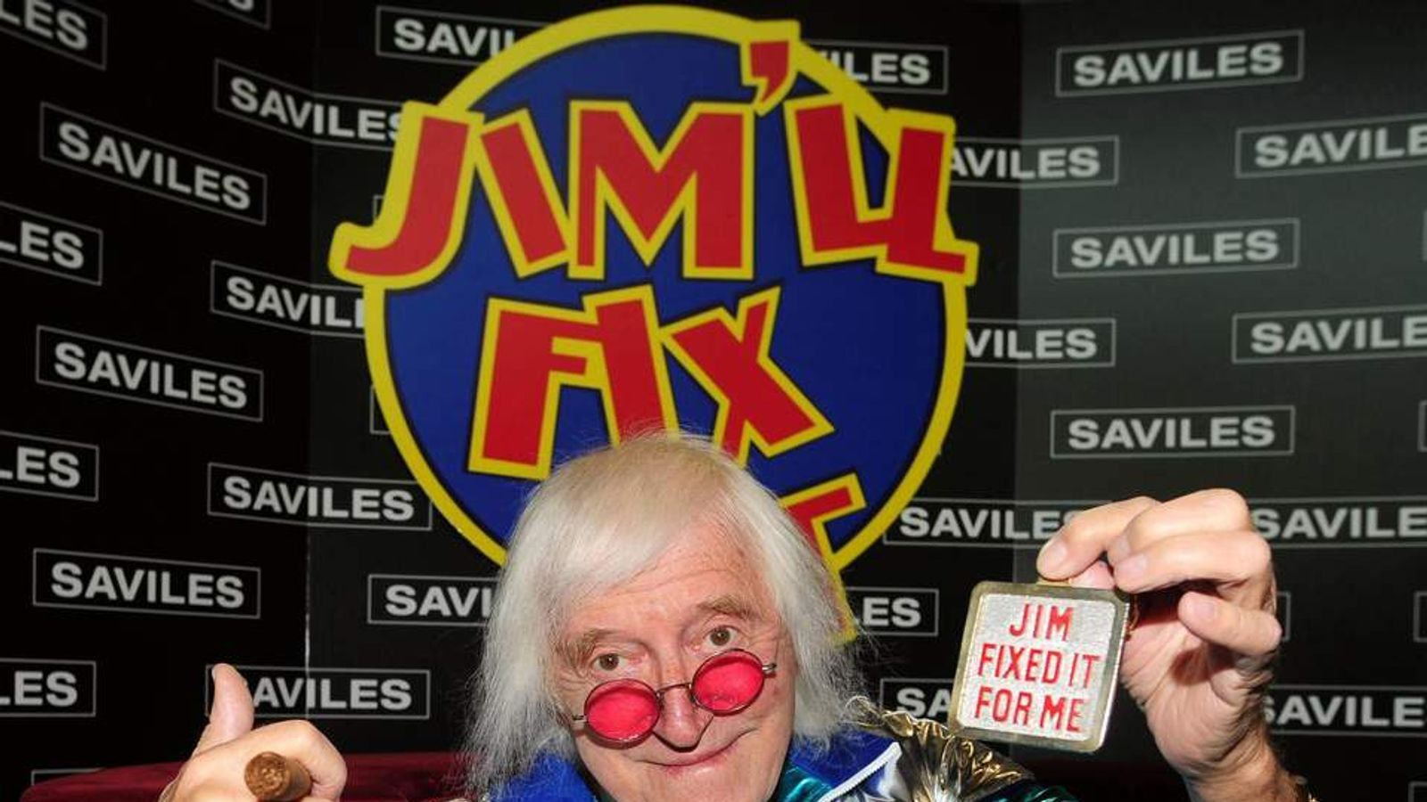 File photo dated 18/05/2009 of Sir Jimmy Savile reunited with his famous Jim'll Fix It chair, as Sir Jimmy's gold suits, Cuban cigars and beloved Rolls-Royce will also go on sale today as the late DJ's belongings goes up for auction.