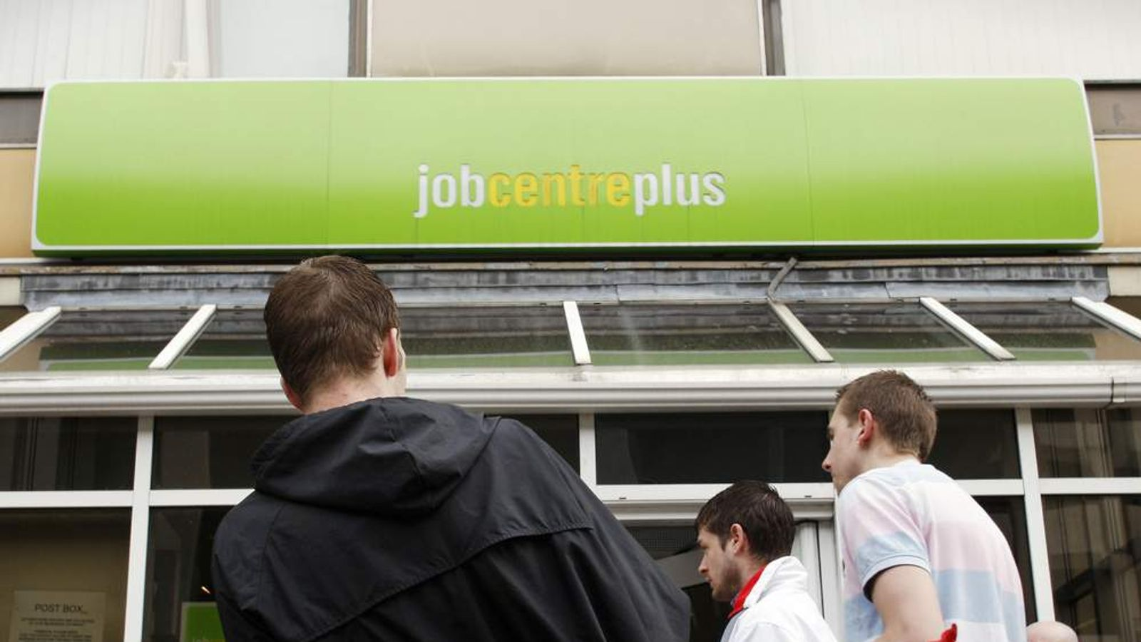 People stand outside the Job Centre in Chatham